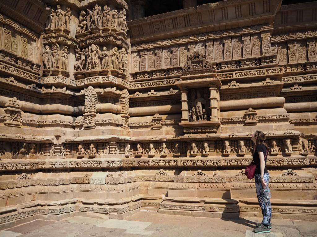 Hats admiring the intricate sculptures at Khajuraho