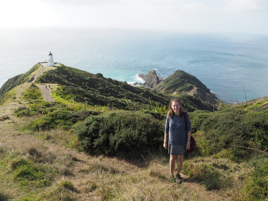 Hats with the lighthouse of Cape Reinga in the distance