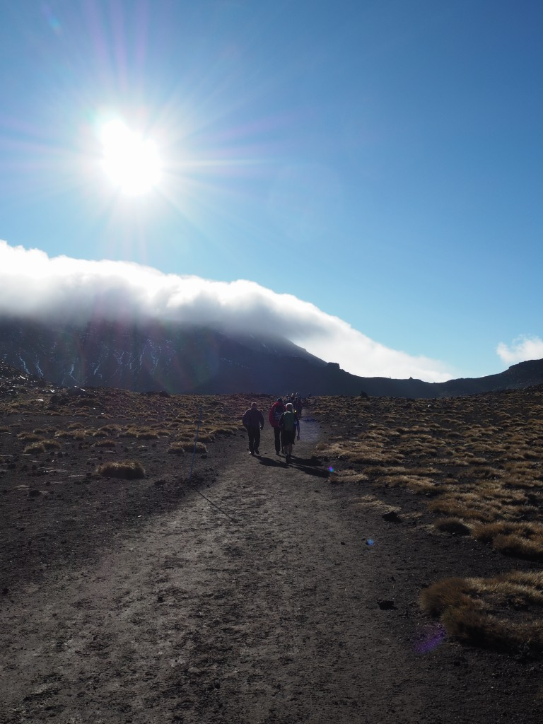 Walking across the Red Crater on the way through the Tongariro Crossing