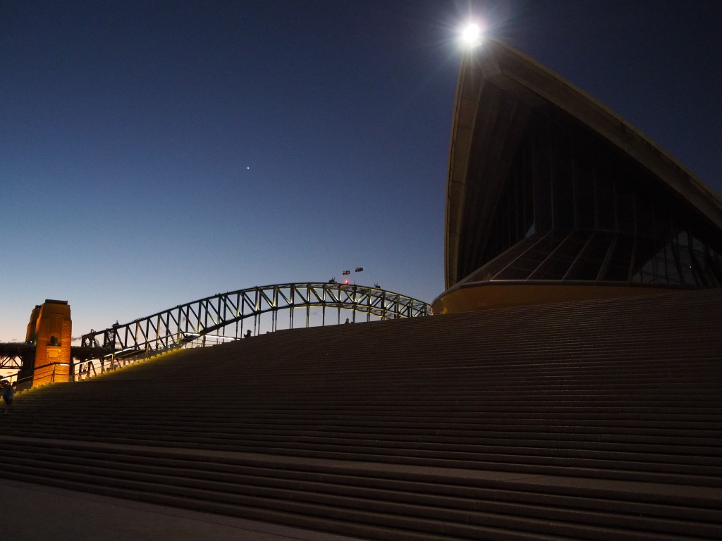 Spaceship like 'petal' of the Sydney Opera House next to the Harbour Bridge