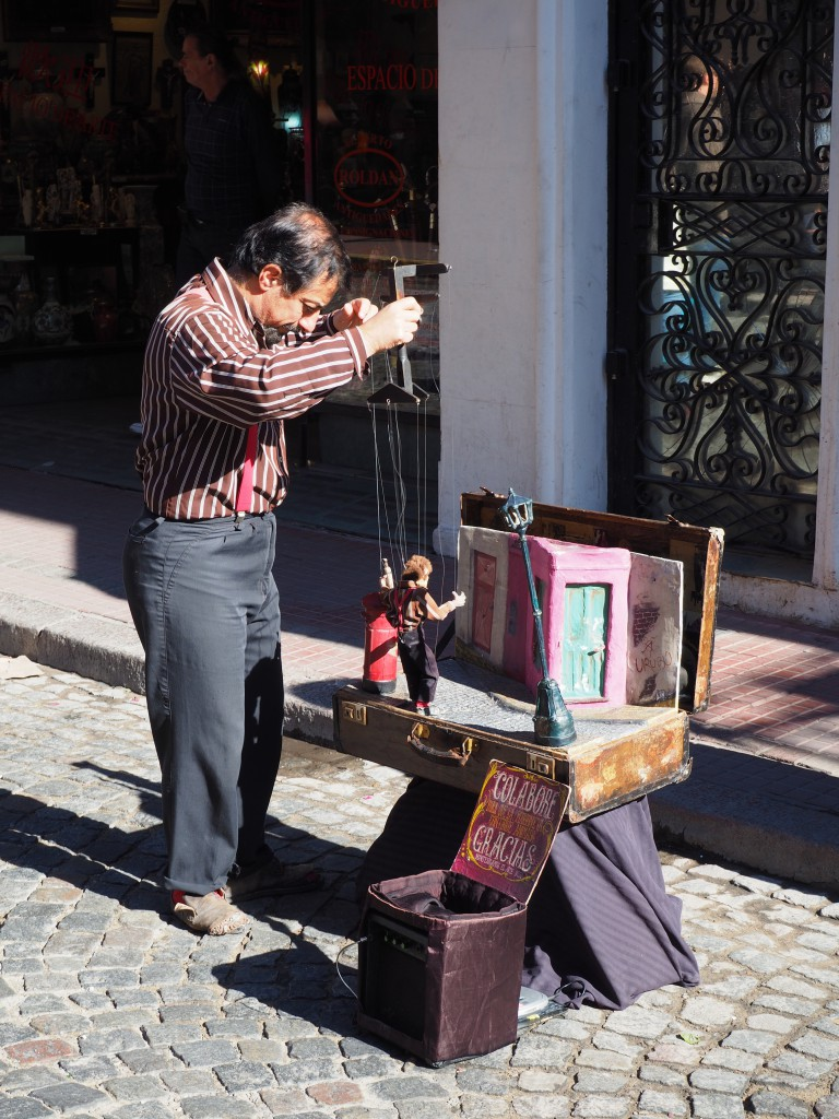 A puppeteer performing on the streets of San Telmo's Sunday market