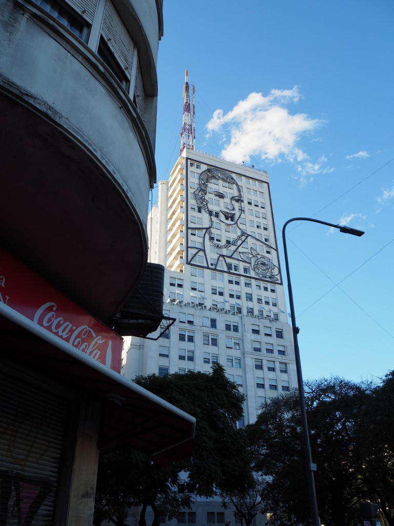 "Eva 'Evita' Peron on the Buenos Aires skyline. The other side features her with a microphone, or as our walking tour guide suggested, ""a guy eating a sandwich"""