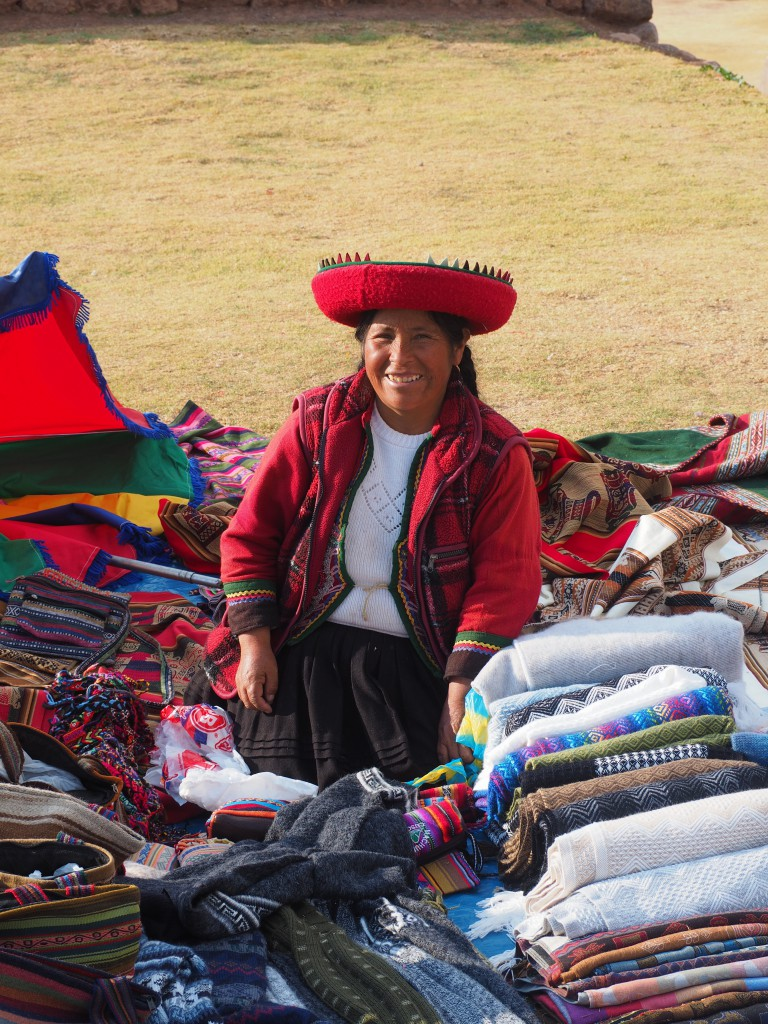 A friendly woman in Chinchero wearing traditional clothes, including her fabulous hat