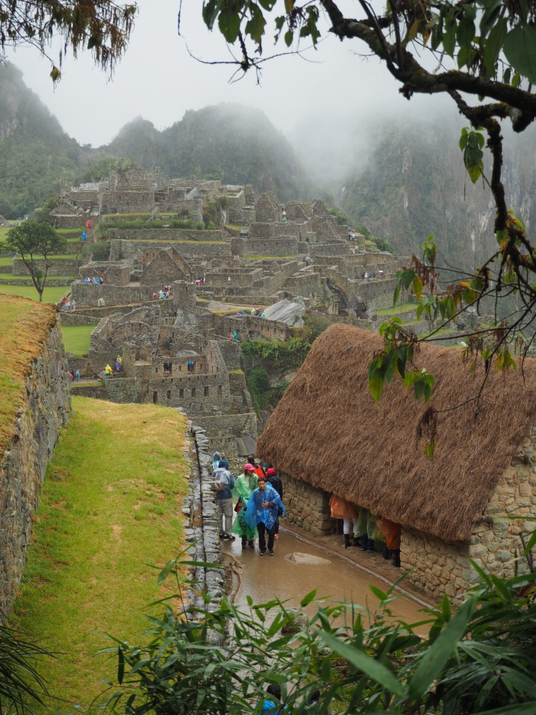 A very wet view of the ruins (and ponchos) when we got back down from Sun Gate