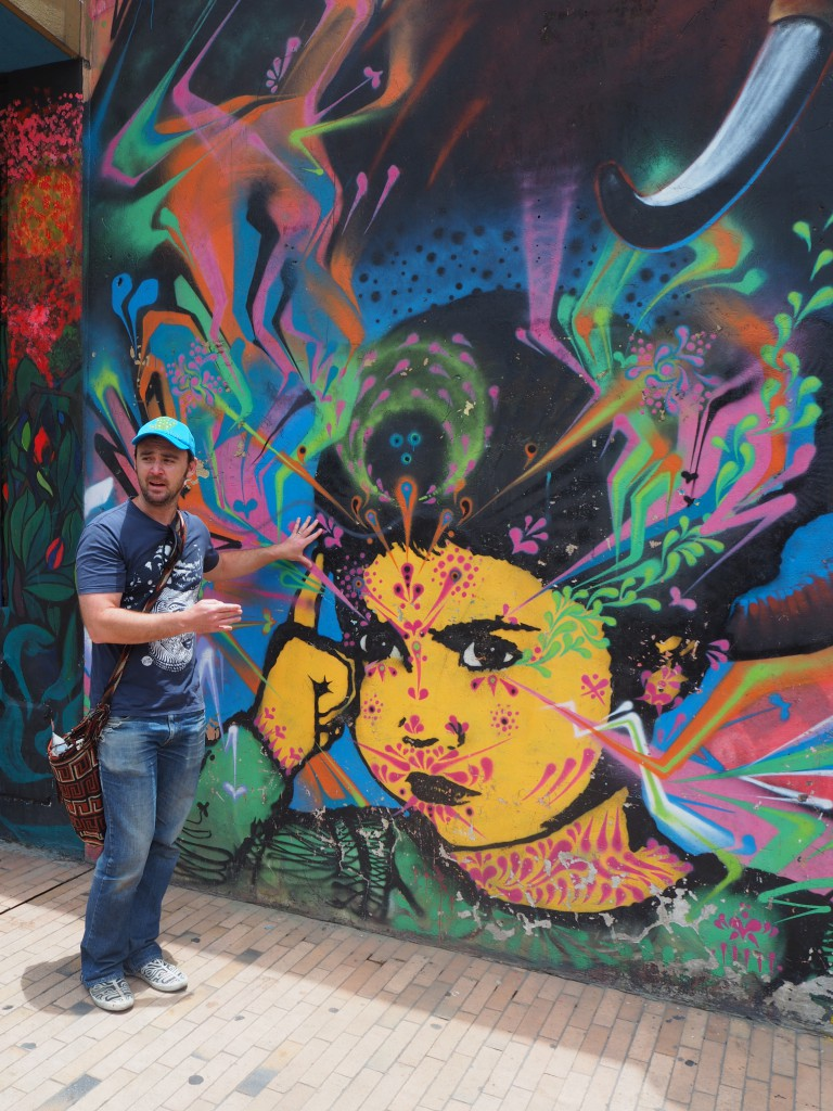 Our guide showing us graffiti art by Stinkfish, one of the most famous street artists on the Bogota graffiti scene